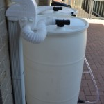 I am looking for a design that I can use to connect my downspouts to a 1,000 liter tote, or a couple of plastic rain barrels.
